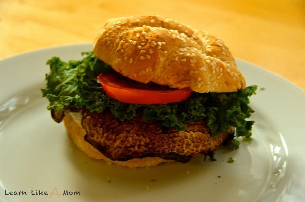 Walnut Kale Pesto Portabello Mushroom Burgers - Learn Like A Mom! https://learnlikeamom.com/walnut-kale-pesto-portabello-mushroom-burgers/ #pestorecipe #walnutkalepesto #portabelloburgerrecipe