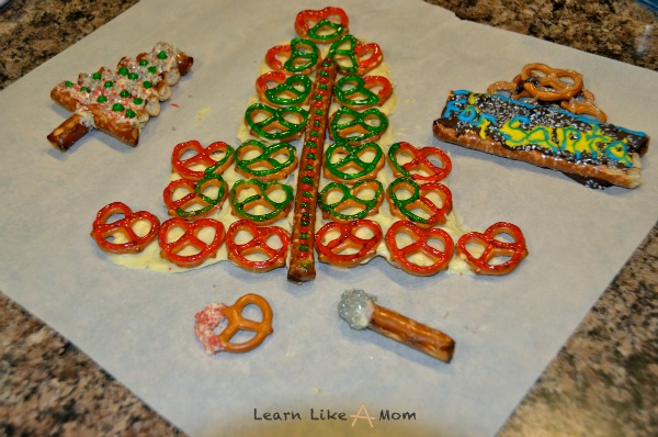 Santa Snacks Made with Pretzels and Chocolate - Learn Like A Mom! These treats are made with love for Santa (or his little helpers!) https://learnlikeamom.com/santa-snacks/ #recipeforsanta #treatsforsanta #chocolatepretzels