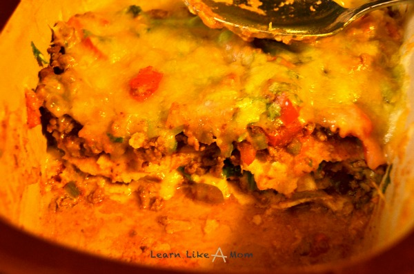 Mexican Lasagna using taco meat - Learn Like A Mom! https://learnlikeamom.com/two-uses-taco-meat/
